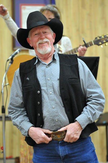 Terry Nash Speaking and Smiling  Colorado Cowboy Poetry Gathering Golden Colorado